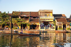 Boat on river in Hoi An, Vietnam. Hoi An is located on the coast of the South China Sea. Is recognised as a World Heritage Site by UNESCO. Market at night with a Royalty Free Stock Image