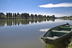 Boat on a river kupa Stock Images