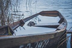 Boat on the river, lake. A boat with oars. Boat on the river, lake. A boat with oars Stock Photo
