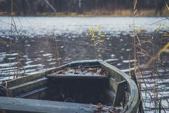Boat on the river, lake. A boat with oars. Boat on the river, lake. A boat with oars Royalty Free Stock Images