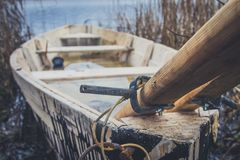 Boat on the river, lake. A boat with oars. Boat on the river, lake. A boat with oars Stock Images