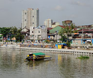 A boat on river in Manila, Philippines Stock Photos