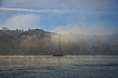 Boat in River Mist Stock Images
