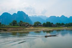 Boat on river on mountains background, Laos Royalty Free Stock Photography