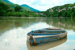 Boat in river on the picturesque landscape Royalty Free Stock Photo