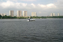 A boat on the river in the residential complex Royalty Free Stock Photography
