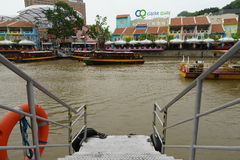 Boat on the river2. Boat on Singapore river. Passing by Royalty Free Stock Photography