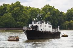 A boat on the river Thames Stock Image