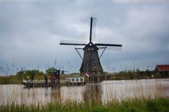 Boat river and windmil. Boar tour along river at kinderdijk village, netherland, seeing the windmil and historical culture Royalty Free Stock Photo