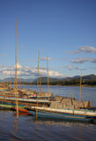 Boat on riverside. Traditional boat park on riverside, Laos royalty free stock photos