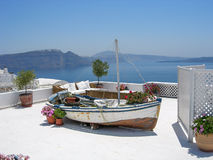 Boat on the roof. A fishing boat on the roof of a house in Santorini, Greece Royalty Free Stock Image