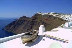 Boat on a blindingly white roof Santorini Royalty Free Stock Photos