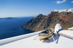 Boat on the roof. White architecture of Oia village on Santorini island, Greece Royalty Free Stock Photography