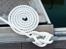 Boat rope. White boat rope on a dock Stock Images