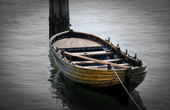 Boat on a rope. Boat attached to dock in lake in cape cod royalty free stock photography