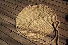 Boat rope circles on wooden deck. Background, texture. stock photos