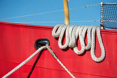 Boat rope at colorful moored fishing vessel Royalty Free Stock Photo