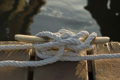 Boat rope moored on jetty stock photos