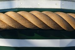 Boat Rope. Thick rope tied around a boat Stock Photography