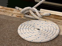 Boat Rope Tied to Cleat. Closeup view of boat rope tied to cleat on dock Stock Photography