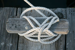 Boat rope tied to cleat. Cleat with rope tied to it Stock Photos