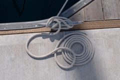 Boat rope tied to dock Royalty Free Stock Images