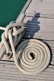 Boat rope twist into circle on dock Royalty Free Stock Photography
