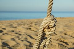 Boat ropes and footprint on sandy beach background.  royalty free stock photos