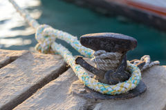 Boat ropes tied to pier stock images