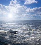 Boat on rough ocean Stock Photos
