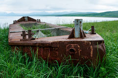 Boat run aground at island Paramushir, Russia Stock Images
