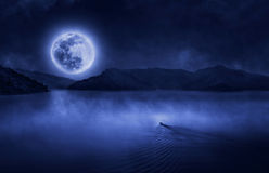 Boat run to the full moon Royalty Free Stock Images