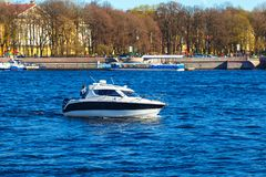 The boat rushes at speed on the river.  Royalty Free Stock Photo
