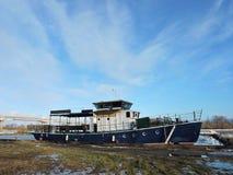 Boat in Rusne Marina. Ship in Rusne island Marina in winter, Lithuania Royalty Free Stock Photo