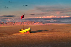 Boat in the Sahara. Small wooden boat at dried of Tunisia is located  in the Sahara, Chott el Jerid - large endorheic salt lake in Tunisia. and is a tourist Royalty Free Stock Image