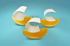 Boat with sail of orange. Sweet Stock Photos