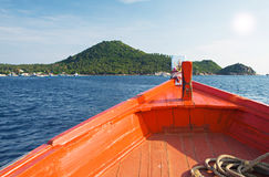 Boat sail to tropical island Stock Photos