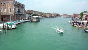 Boat sailing in the canal in the island of Murano stock video