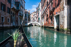 Boat sailing on a canal in Venice Stock Photo