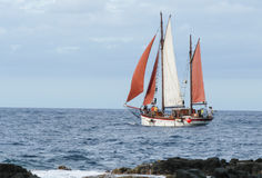 Boat sailing on the coast of Saint Paul on La Reunion Royalty Free Stock Photos