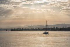 Boat sailing at dawn along the Lima river stock photography