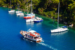 Boat sailing in the grand canal of Paxos Island Royalty Free Stock Photos
