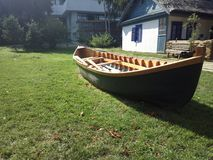 A boat on sailing on the grass. Visiting The Village Museum in Bucharest Stock Images