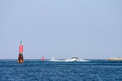 Boat sailing into harbor Stock Photo