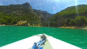 Boat sailing in the Lac de Sainte-Croi in the Gorges du Verdon stock footage