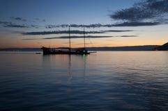 A Boat Sailing in Lake Geneva at Sunset Stock Image