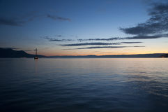 A Boat Sailing in Lake Geneva at Sunset Stock Images