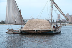 A boat sailing on the Nile. Sailing boat in the Nile carries hay Stock Photo