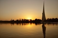 Boat sailing on the Nile river at sunset, Luxor, Egyptian. royalty free stock photo