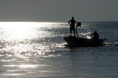 Boat sailing out. Fisherman in boat sailing out stock image